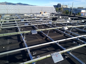 Microinverters attached to high-strength, yet flexible framing.