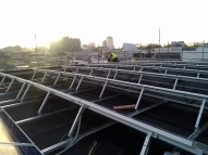 The solar panels capture the last of the setting sun over the city being rebuilt. They will be witness to 25+ years of sunshine & still be operating!
